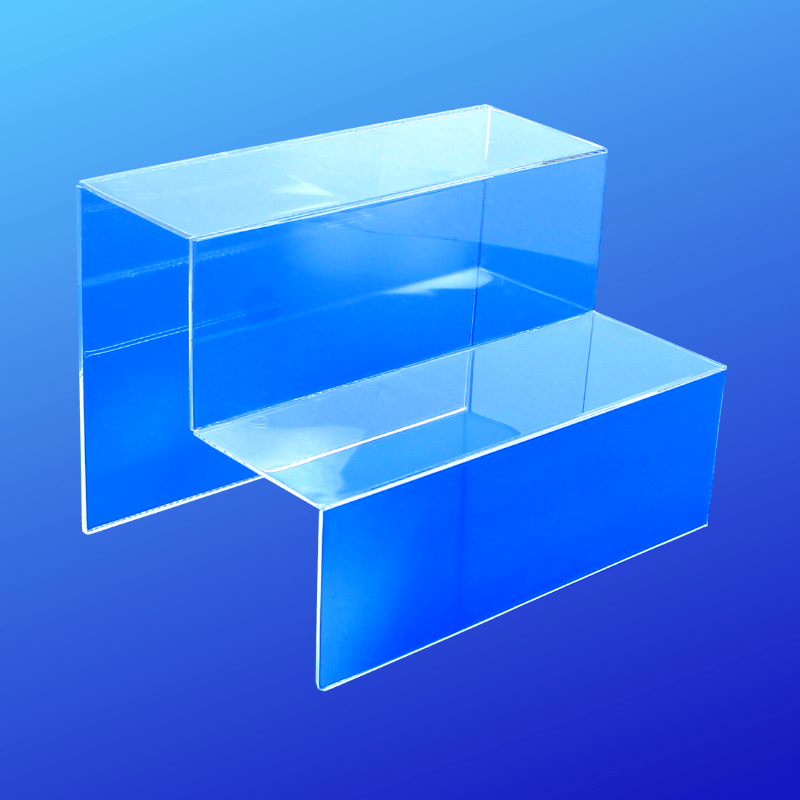 Acrylic display riser with multiple steps for displaying products