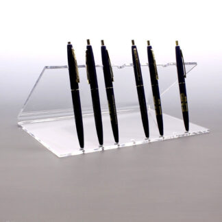 Acrylic stand holding multiple pens upright