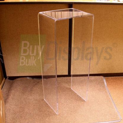 36 to 48 inch high acrylic display riser shaped like a waterfall