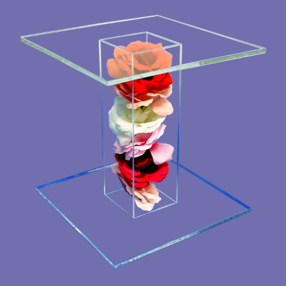 Acrylic pedestal display filled with roses