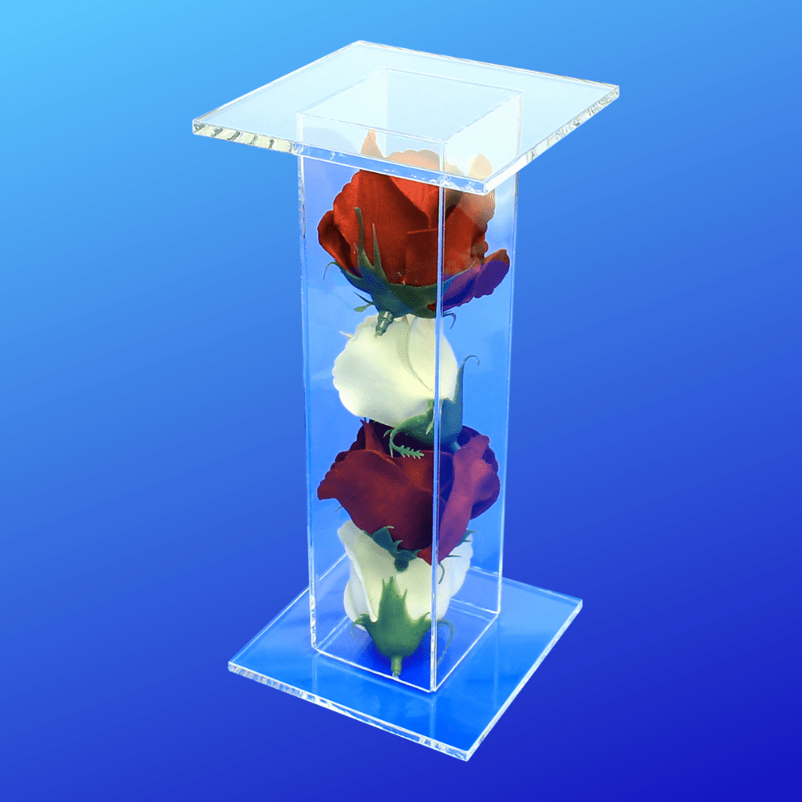 Pedestal display stand filled with red and white roses
