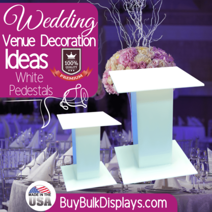 White acrylic pedestals for wedding venue decoration ideas