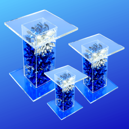 Blue and silver bow filled acrylic pedestal stand displays