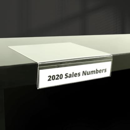 Clear acrylic shelf sign holder