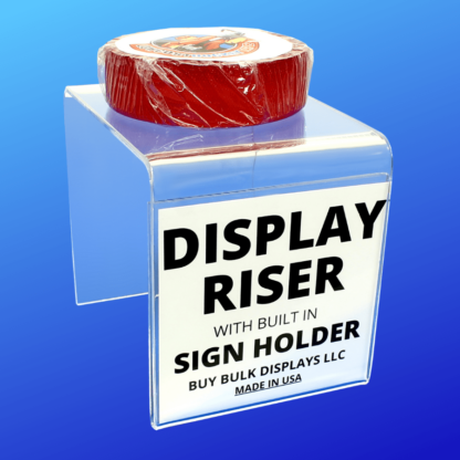 Acrylic riser with built in sign holder